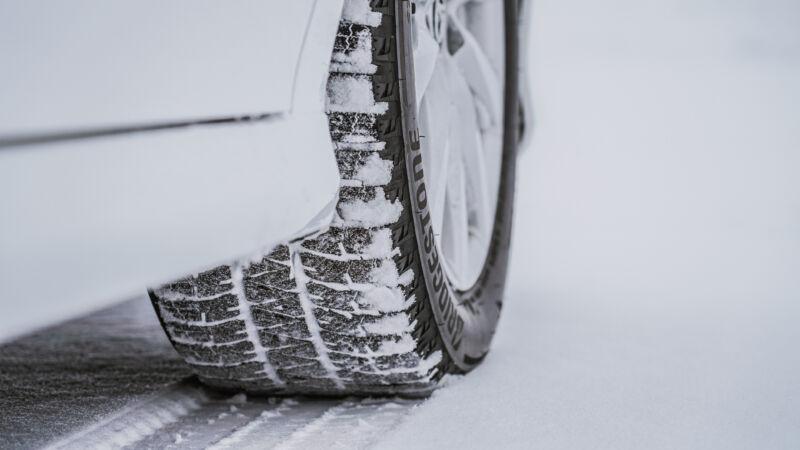 A closeup of Bridgestone's latest Blizzak tire in its natural environment.