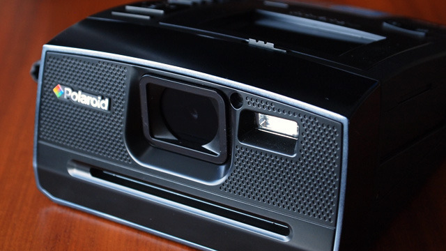 The front of the Z340 evokes the design of long-since discontinued Spectra cameras, with a large lens opening, flash, and slot for prints.
