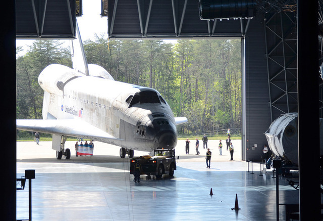 After its nose-to-nose meeting with Enterprise, Discovery takes its place inside the McDonnell Space Hangar.