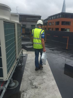 An engineer installing one of the new smaller base stations.