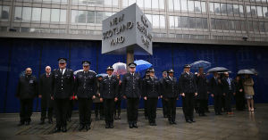 Scotland Yard officers observe two minutes silence in London on January 8, 2015, following the atrocity at satirical magazine <em>Charlie Hebdo</em> in Paris.