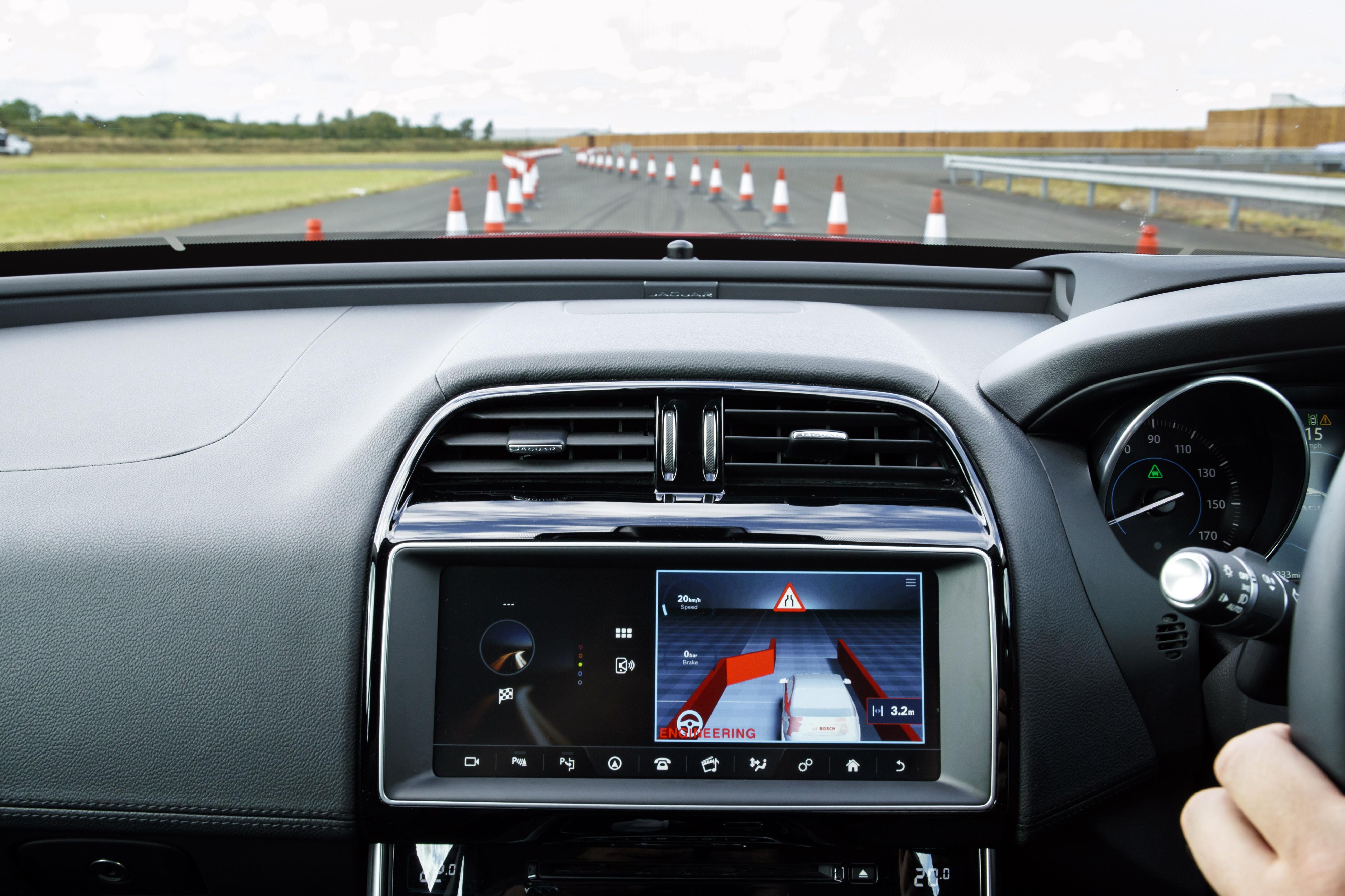 "Jaguar Land Rover's ""Roadwork Assist"" feature at work."