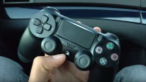 The possibly redesigned Dual Shock 4 controller, with a transparent strip across the top.