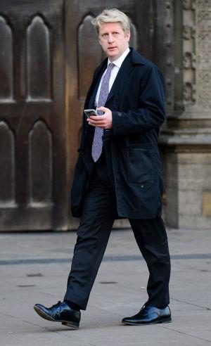 Jo Johnson MP, walking past Westminster Abbey