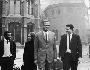 Malcolm X in Oxford with Eric Abrahams, the Student Union president, before addressing university students on the subject of extremism and liberty, December 3 1964.