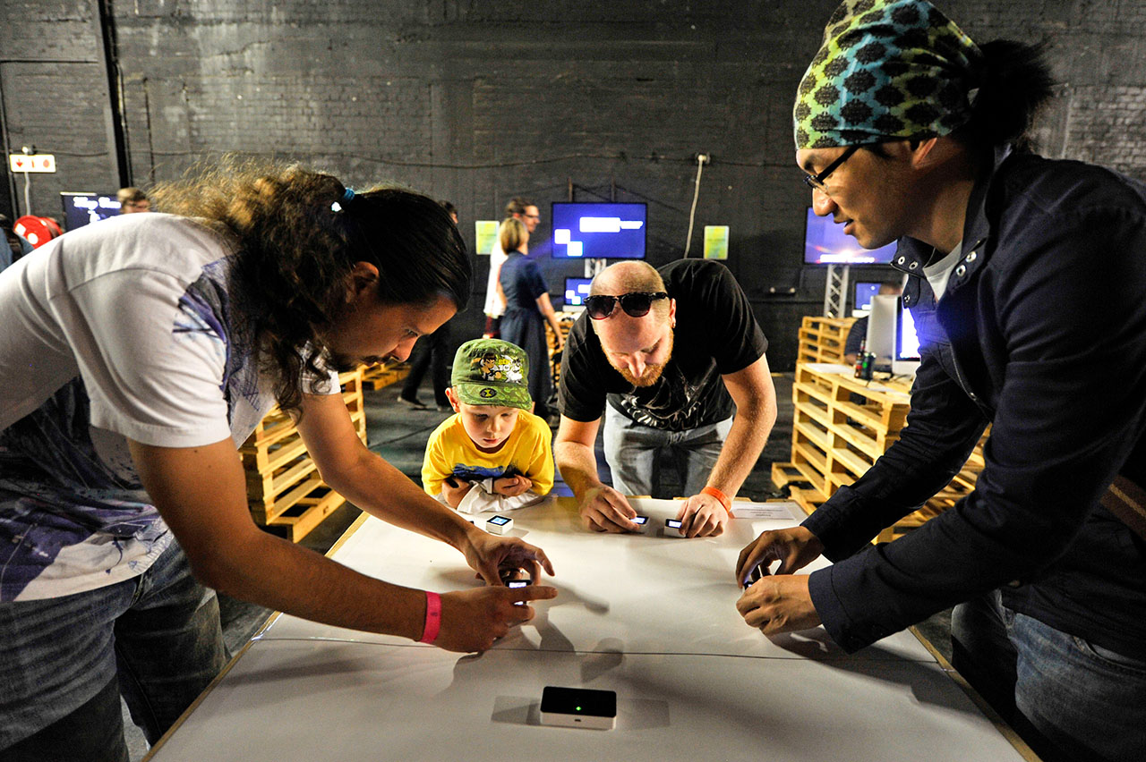 Attendees try out game demos at the A Maze festival.