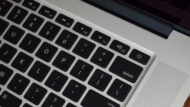 The backlit keyboard is more Air-like, including the revised power button.