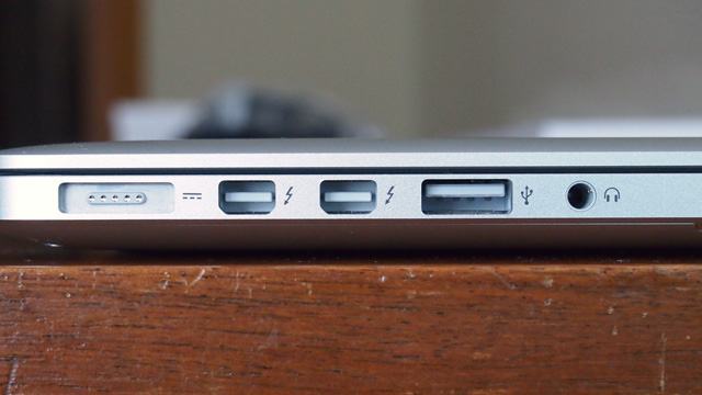 On the left, the Retina MacBook Pro has a MagSafe2 port, two Thunderbolt ports, and a USB 3.0 port.