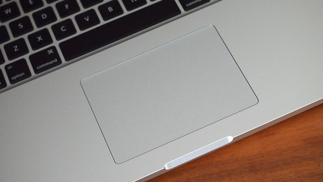 "The same huge glass trackpad dominates a large portion of the 15"" Retina MacBook Pro when opened."
