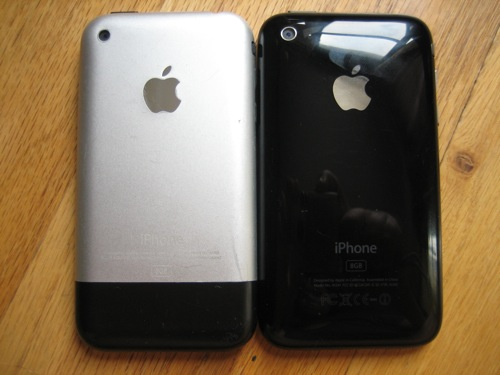 An original iPhone next to an iPhone 3G