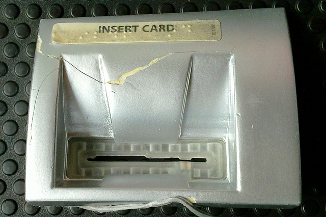 "The front of a card skimmer discovered by <a href=""http://www.flickr.com/photos/27047834@N02/"">Aaron Poffenberger</a> found placed over the card slot of a Diebold ATM—note the notch for the reader heads."