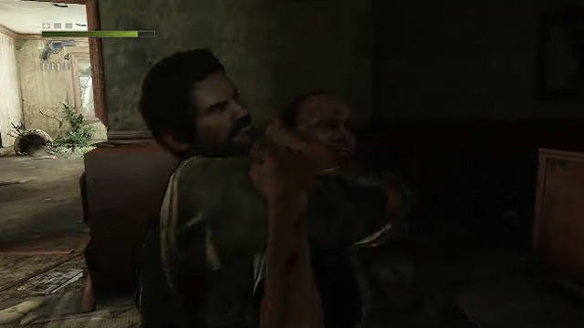 Joel strangles an enemy in <em>The Last of Us</em>.