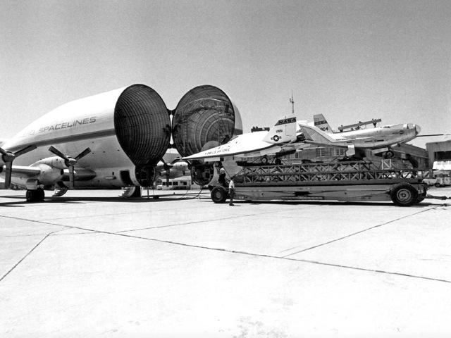 A crew loads the X-24 and HL-10 into the Super Guppy for storage