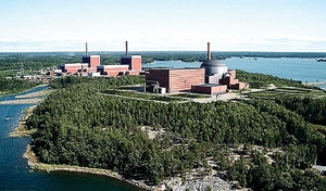 An artist's rendering of the new Olkiluoto 3 reactor in 2009 (foreground) and the site's existing two units. The new unit, now under construction, is based on AREVA's European pressurized-water reactor design and will feature a full suite of digital