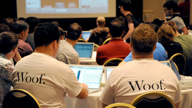 Woof. Woof. Two attendees at C4[2] last fall watch a presentation by Mike Lee.