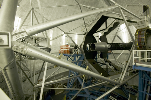 The Keck telescope's primary mirror (right) is formed from an array of smaller hexagonal mirrors.