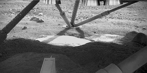 When Phoenix Lander touched down on Mars, its rocket engines blasted away top soil to expose a layer of subsurface ice.