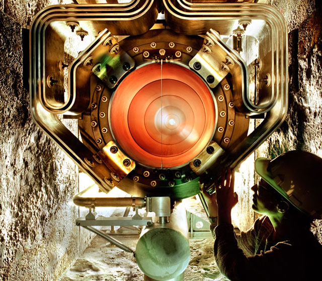 A technician works on equipment that feeds a particle beam into the MINOS neutrino oscillation experiment.