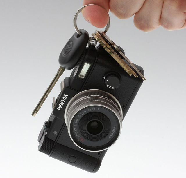 The Pentax Q is so small it could be mistaken for a replica camera key fob.
