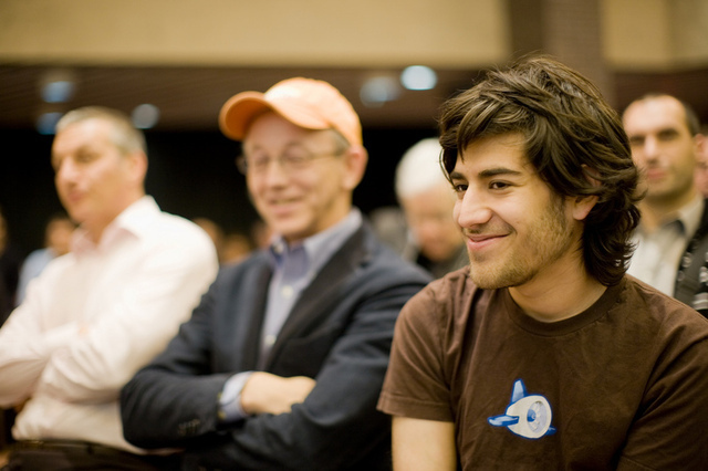 Aaron Swartz in 2008, with former Red Hat CEO Bob Young in the background