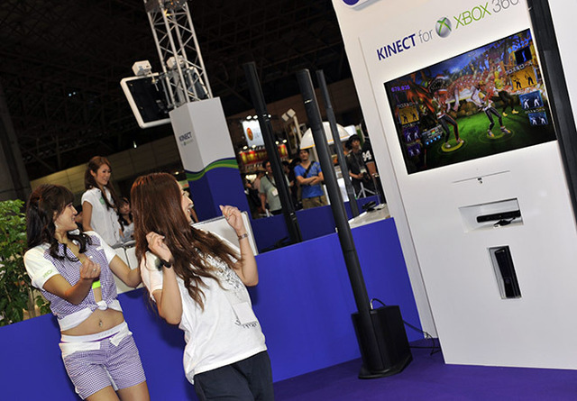 Midori Kaneko, right, enjoys a game of <em>Dance Central 2</em> for Kinect at the Microsoft booth at Tokyo Game Show on Friday. But she says she won't buy an Xbox.