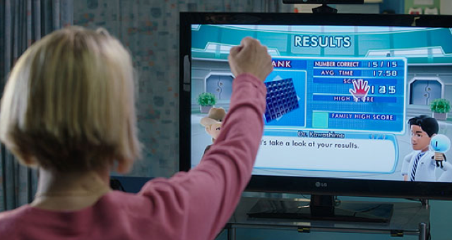 A patient uses a Kinect application as part of a rehabilitation exercise.