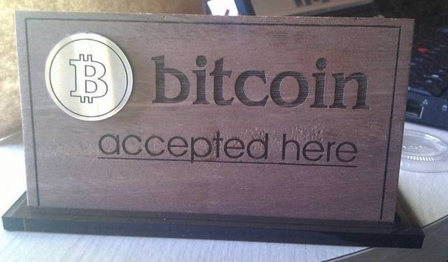 A sign advertising the acceptance of Bitcoin at Neil's Bodega in British Columbia