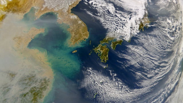 Pollution spreading over the ocean from China.