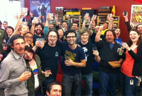 The Double Fine team celebrates becoming only the second project in Kickstarter history to bring in over $1 million/