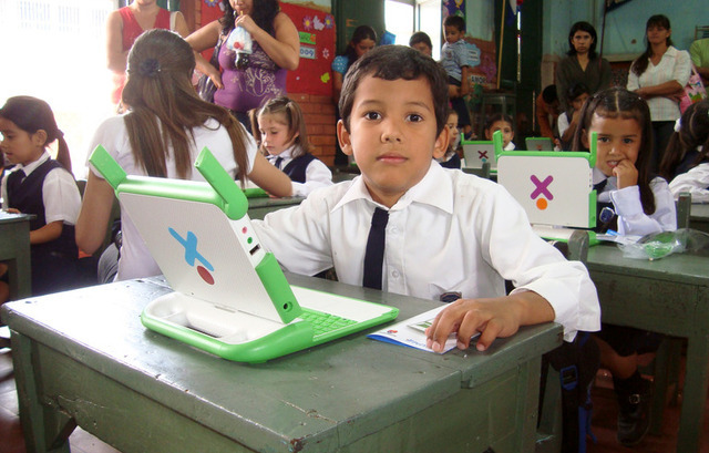 A student in Paraguay using his OLPC laptop
