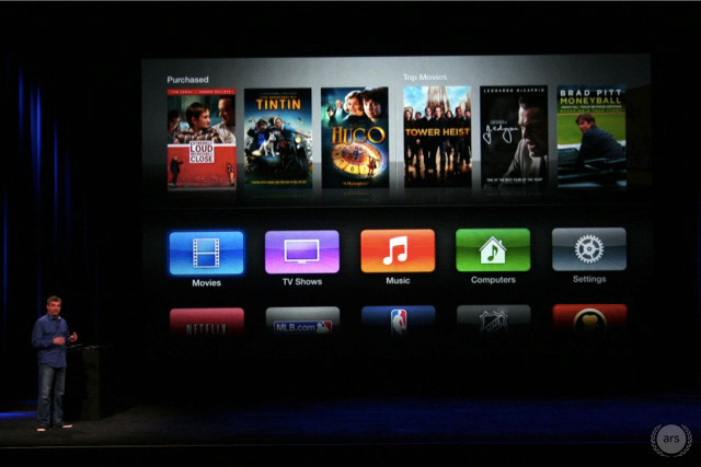 Apple SVP of Internet Services Eddie Cue shows off the new AppleTV user interface.