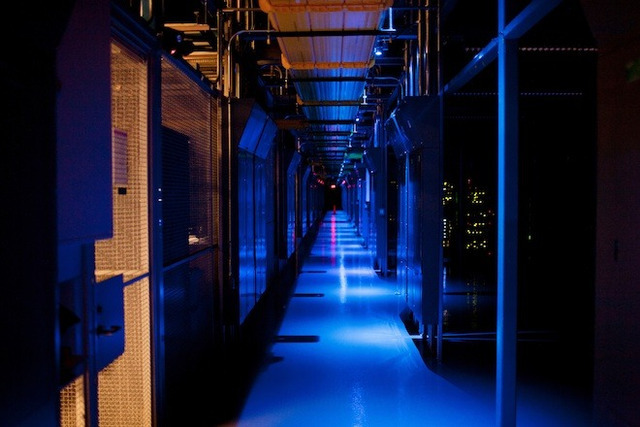 Inside the massive data centers run by Equinix, the lights are on in some cages, but off in others. Photo: Peter McCollough/Wired.com