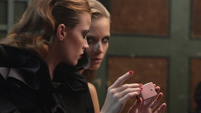 Models vamping in Dolce&Gabbana flaunt the Sony Ericsson Jalou