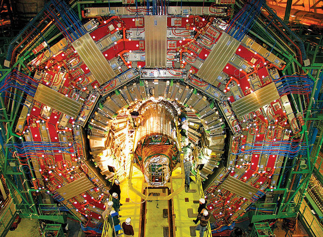 The CMS detector, with some puny humans shown for scale.