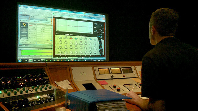 Chicago Mastering Service engineer Jason Ward loads up songs to compare in the mastering room.