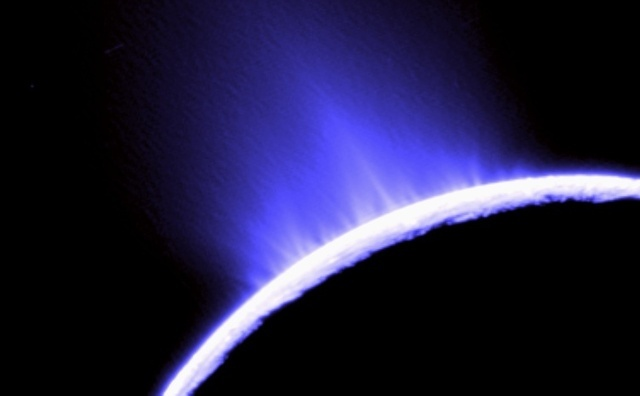 The geysers of Enceladus pretty clearly indicate the presence of liquid water.