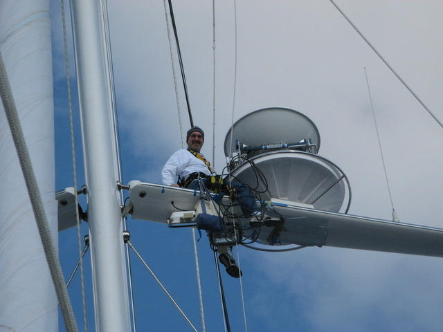 Ed Lasher up the mast of the sailing yacht Georgia—a typical day in the life of a super-yacht IT specialist.