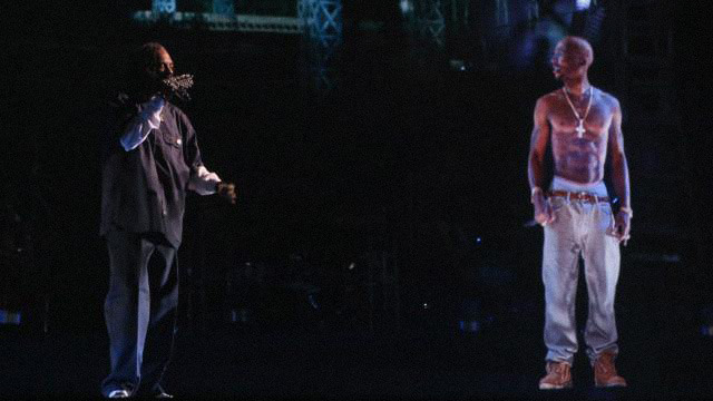 Snoop performs next to the Tupac projection on the stage at Coachella.