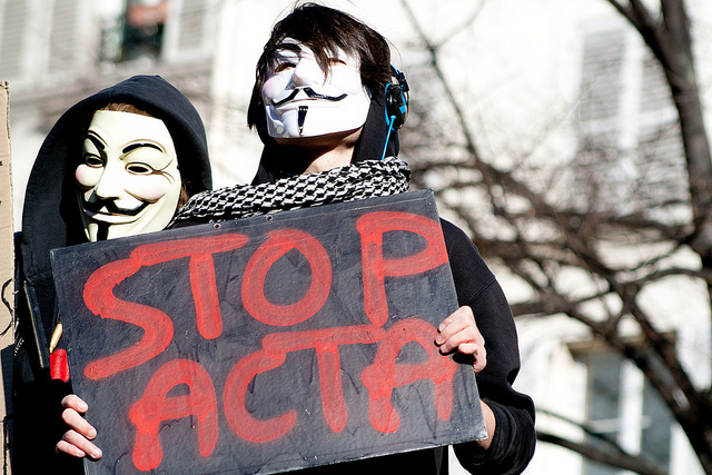 ACTA protestors send a message in Paris this past February.