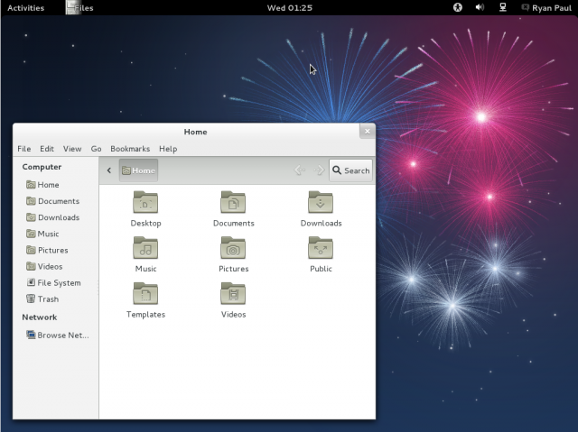 Fedora 17's GNOME 3.4 desktop. The default wallpaper needs more cow.