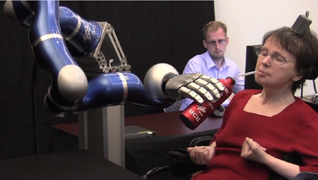 Paralyzed woman controls robotic arm, sips coffee