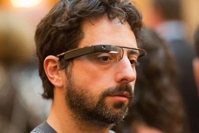 Google cofounder Sergey Brin wears a prototype pair of Google Glasses