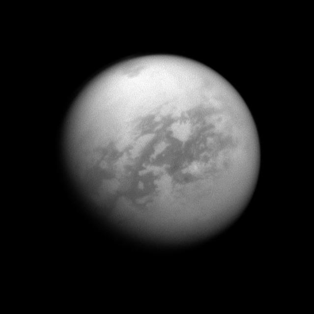 Titan, under the smog. The methane sea known as Kraken Mare is the dark smuge at the top of the image.