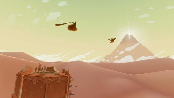 Art can be interpreted many ways. For instance, that orange pillar could represent the PlayStation 3, and the flying figures could represent thatgamecompany.