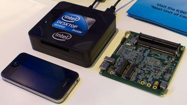 Intel's NUC prototype and motherboard pictured next to an iPhone.