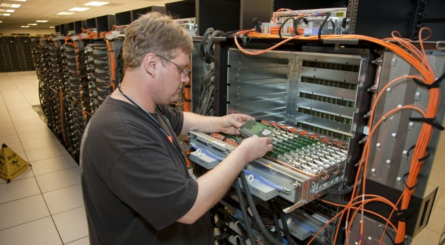 An IBM technician loads CPUs into Sequoia, the world's fastest supercomputer.