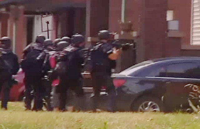 A still from the SWAT raid, captured on video by a local TV crew