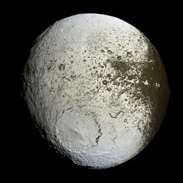 Saturn's moon Iapetus. Note the odd shape and the equatorial ridge (best visible at the right edge of the moon).
