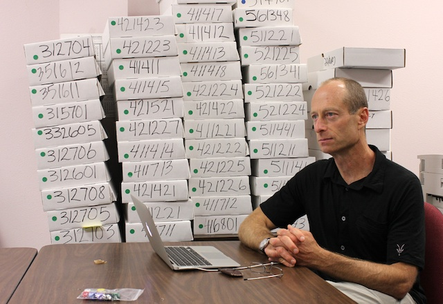 Philip Stark with his boxes of ballots.