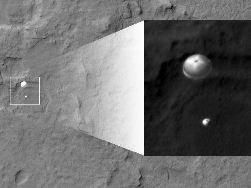 Curiosity's parachute slows it down as it plunges towards the surface of Mars.